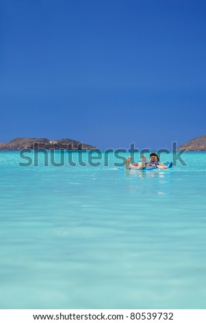 Drifting off on the calm waters of a tropical bay - stock photo