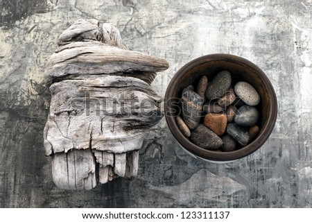 Driftwood and Stones - stock photo