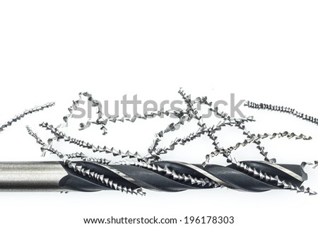 Drill and metal shavings on white background - stock photo