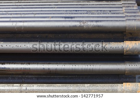 Drill-pipe on Oil Rig Pipe Deck - stock photo