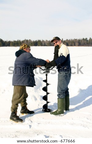 Drilling an ice hole - stock photo