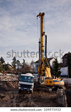 Drilling and concreting building foundation - stock photo