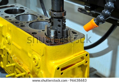 Drilling of an engine block - stock photo