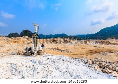 drilling ring drill the rock hole for demolition at mine site - stock photo