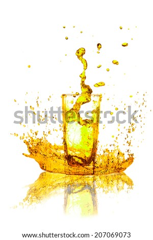 Drink a glass of yellow splash out on a white background. - stock photo
