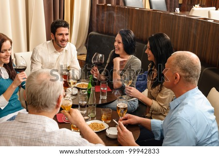 Drink after work happy colleagues having fun at fancy restaurant - stock photo