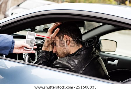 drink and drive crashed driver due to being subject to test for alcohol content with use of breathalyzer . he is devastated   - stock photo