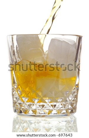 Drink being poured, high-key background - stock photo