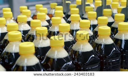 drink bottled, production detail. yellow caps  - stock photo