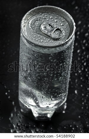 drink can with water droplets close up on black background - stock photo