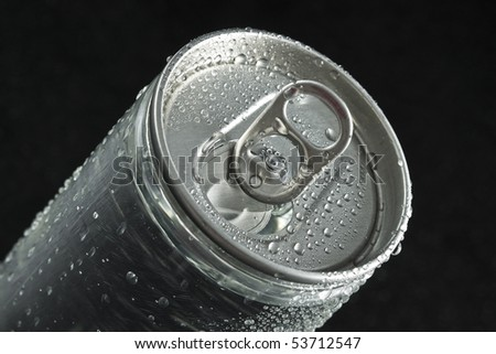 drink can with water drops close up macro on black background - stock photo