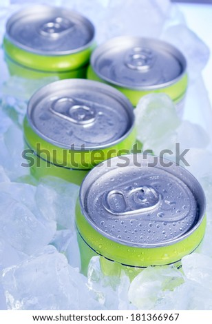 drink cans with crushed ice - stock photo