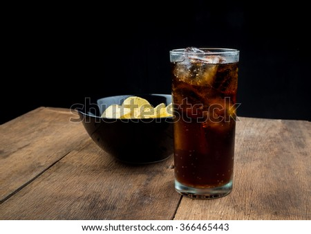 Drink cola in glass on wood table. - stock photo
