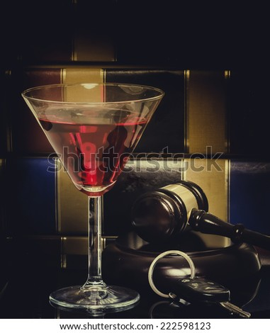 Drink driving law legal concept image - car keys - wine glass and gavel with legal books in background, - stock photo