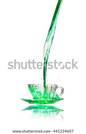 Drink green splash out of glass on a white background. - stock photo