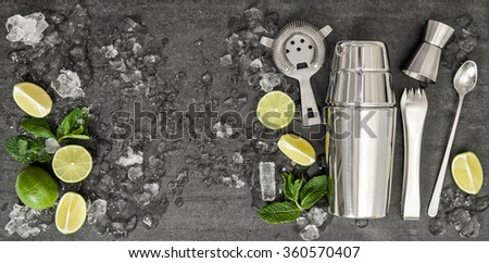 Drink making tools and ingredients for cocktail lime, mint, ice. Top view - stock photo