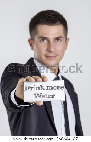 Drink more Water - Young businessman holding a white card with text - vertical image - stock photo