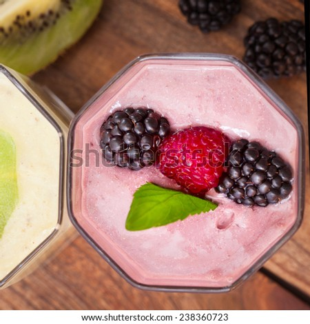 Drink smoothies four summer strawberry, blackberry, raspberry on wooden table. healthy lifestyle concept. - stock photo
