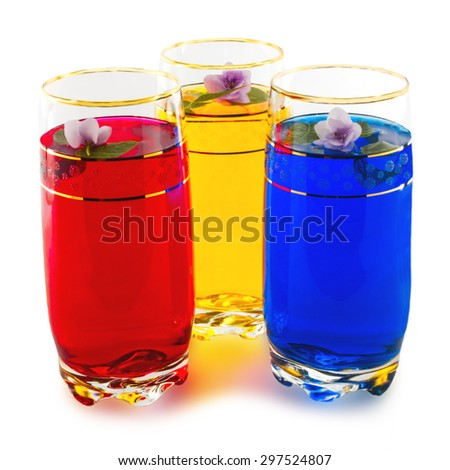 Drink three colors and flowers, the triad of red, yellow and blue, white background - stock photo