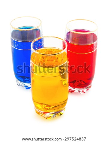 drink three colors, the triad of red, yellow and blue, white background - stock photo