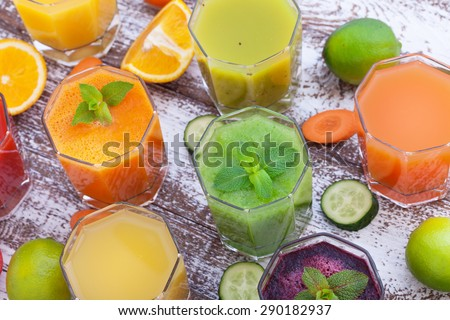 Drink vegetable in glasses on wooden table. Smoothies from vegetables for breakfast - stock photo