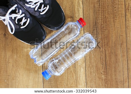 drink water during training. for fitness and workout needs only athletic shoes and a lot of drinking water - stock photo