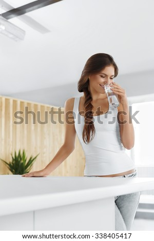 Drink Water. Happy Beautiful Woman Drinking Fresh Pure Water. Healthcare. Drinks. Healthy Eating. Healthy Lifestyle. Health, Beauty, Diet Concept.  - stock photo