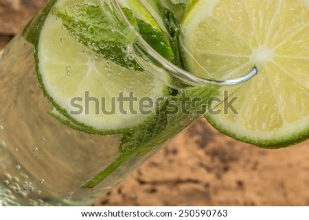drink with lime and mint - stock photo