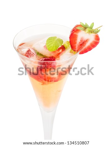 Drink with strawberries and mint in a champagne flute - stock photo