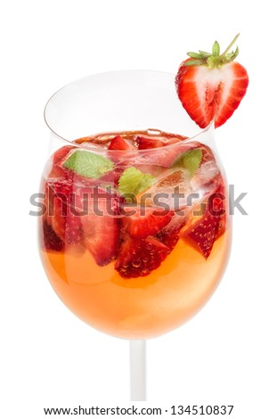 Drink with strawberries and mint in a wine glass - stock photo