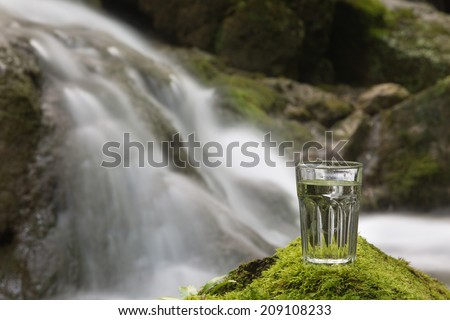 Drinkable water from the mountain river source - stock photo