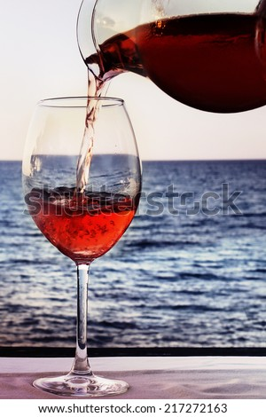 drinking a good glass of wine at the sea - stock photo