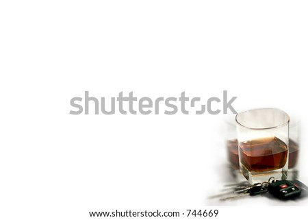 Drinking and driving image - glass and keys with blurred effect. - stock photo
