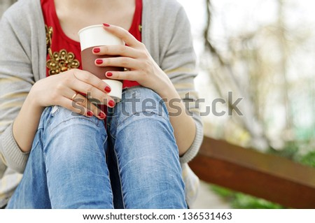 Drinking coffee outdoors - stock photo
