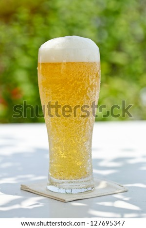 Drinking cold beer on the terrace - stock photo