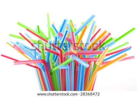 Drinking straws in multiple colors, isolated on white. - stock photo