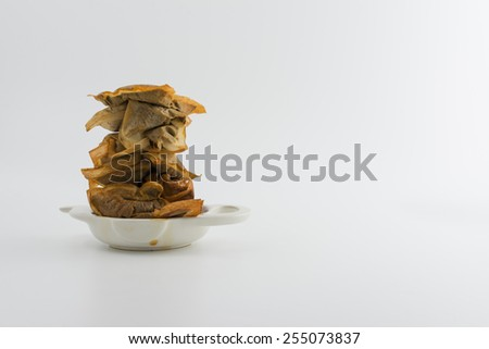 Drinking too much tea - stack of used teabags in stained used tea bag holder with copy space - stock photo