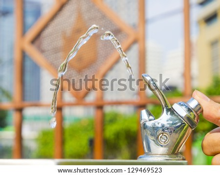 drinking water faucet at public park. - stock photo