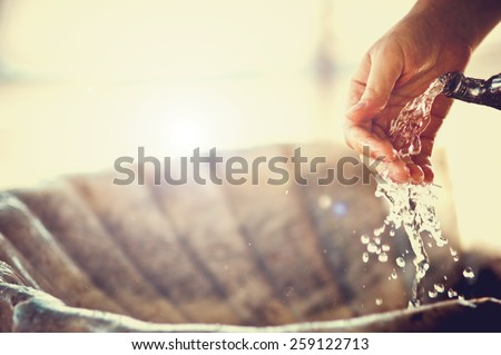 Drinking water running from an old water tap - stock photo