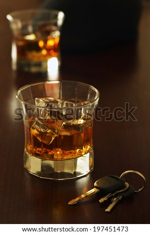 drinks at a bar with keys to a car don't drink and drive - stock photo