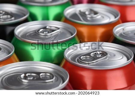 Drinks like cola, beer and lemonade in cans - stock photo