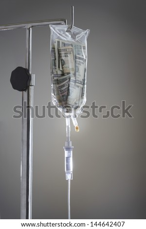 Drip bag on stand against grey background - stock photo
