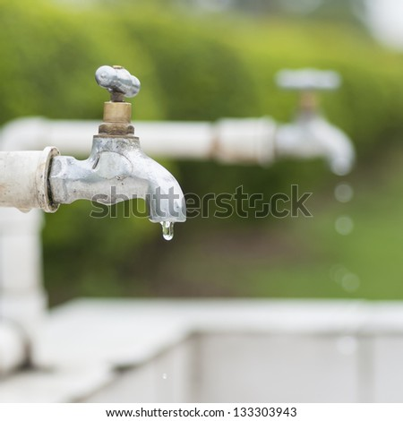 Dripping faucet. - stock photo