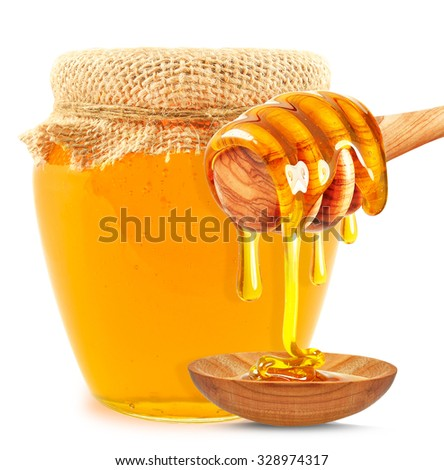 dripping honey on the spoon and honey in a jar isolated on white backgroun - stock photo