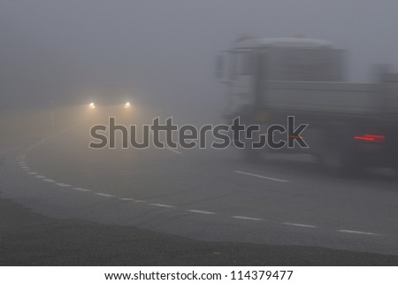 Drive in the morning fog - stock photo