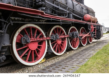 Drive wheels of a steam locomotive - stock photo