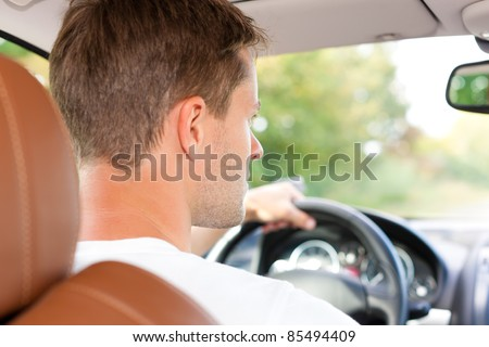 Driver is sitting in his car or van and is driving - stock photo
