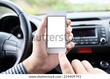 driver sitting in the car and holding a touch phone with isolated screen  - stock photo
