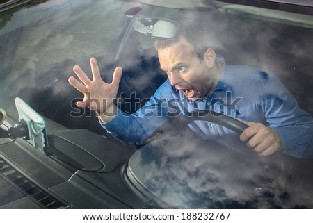 Drivers GPS navigation broke and show him a wrong way. Driver is lost and mad! - stock photo