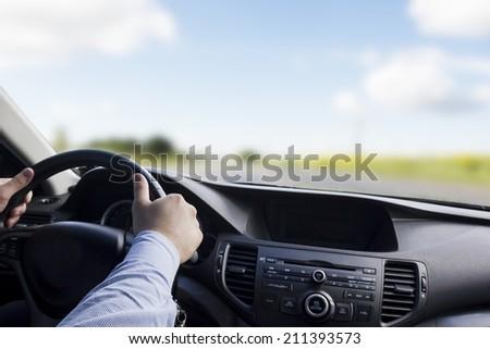 Driving a car at night - stock photo